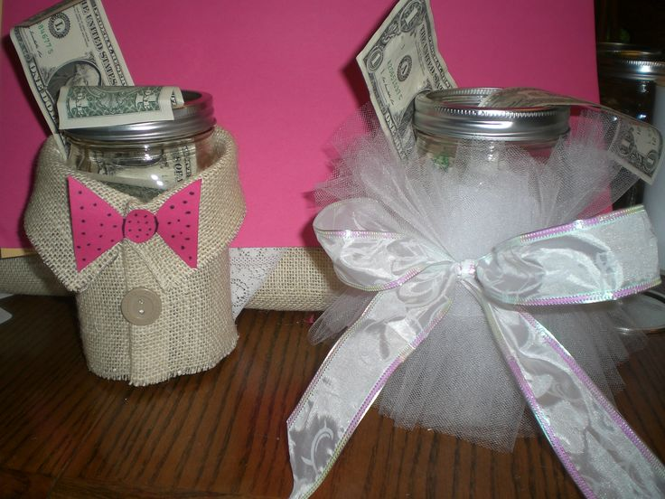 Dollar a Dance jars. If you want to dance with the bride or the groom you donate $1 to the jar at the reception to dance with either the bride or the groom.( Our groom was wearing a Khaki colored tux.)