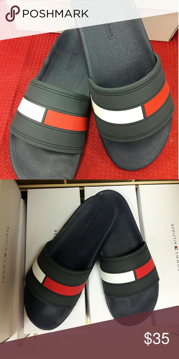 Tommy Hilfiger  Men's Elwood Slide Sandals Tommy Hilfiger  Men's Elwood Slide Sandals   Tommy Hilfiger brings their signature look to your relaxed look with these contemporary slide sandals;  Open toeSlip-on styleOnly available at Macy'smanmade upper; manmade soleImported Tommy Hilfiger Shoes Sandals & Flip-Flops