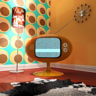 So Retro. 'space age' orange plastic-moulded tv and dig that wallpaper...