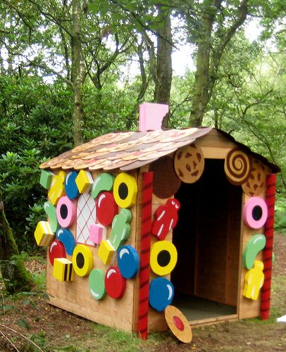 "Outdoor gingerbread house. Could just as easily be an indoor box gingerbread house and the children could cover the outside with big paper ""candies"" they make with paint, paper, and glitter."