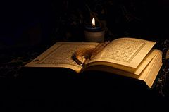 Laylat-al-qadr:  the Quran occurred in two phases, with the first phase being the revelation in its entirety on Laylat al-Qad ( https://www.pinterest.com/pin/416864509236637193/ ) -R to the angel Gabriel (Jibril in Arabic ....  https://www.pinterest.com/pin/416864509234268443/ ) in the lowest heaven, and then the subsequent verse-by-verse revelation to Muhammad by Gabriel, across 23 years....   https://www.youtube.com/watch?v=K9OnM_DLX9A