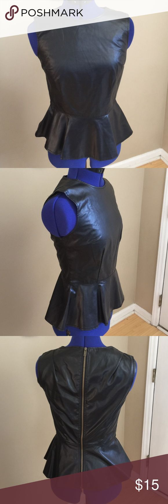 Size small faux leather black peplum top Small.  Faux leather black peplum top. Full back zip. Tops Blouses
