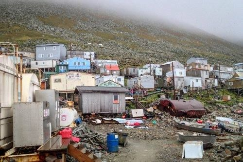 Alaska's Diomede Island that is nestled 2 1/2 miles from Diomede Island, Russia. The border on the Bering Sea Strait.