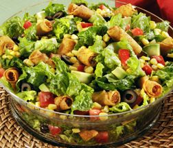 The Jose Olé Fiesta Taquito Salad with Creamy Cilantro Lime Dressing is the perfect salad for your next party.