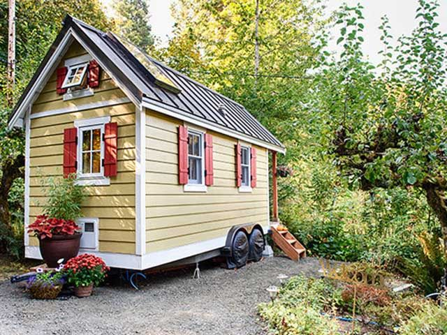 Brittany Yunker built her 160-square-foot home, located on the shores of the Puget Sound in Olympia, Washington, using Tumbleweed Tiny House Company's Cypress 18 Equator building plans, one of the company's most popular designs. The house-on-wheels, which is available to rent, sits on an 18-foot flatbed and is equipped with electricity and a small RV-style hot water heater for the sink and shower. Look inside the Bayside Bungalow.   - CountryLiving.com
