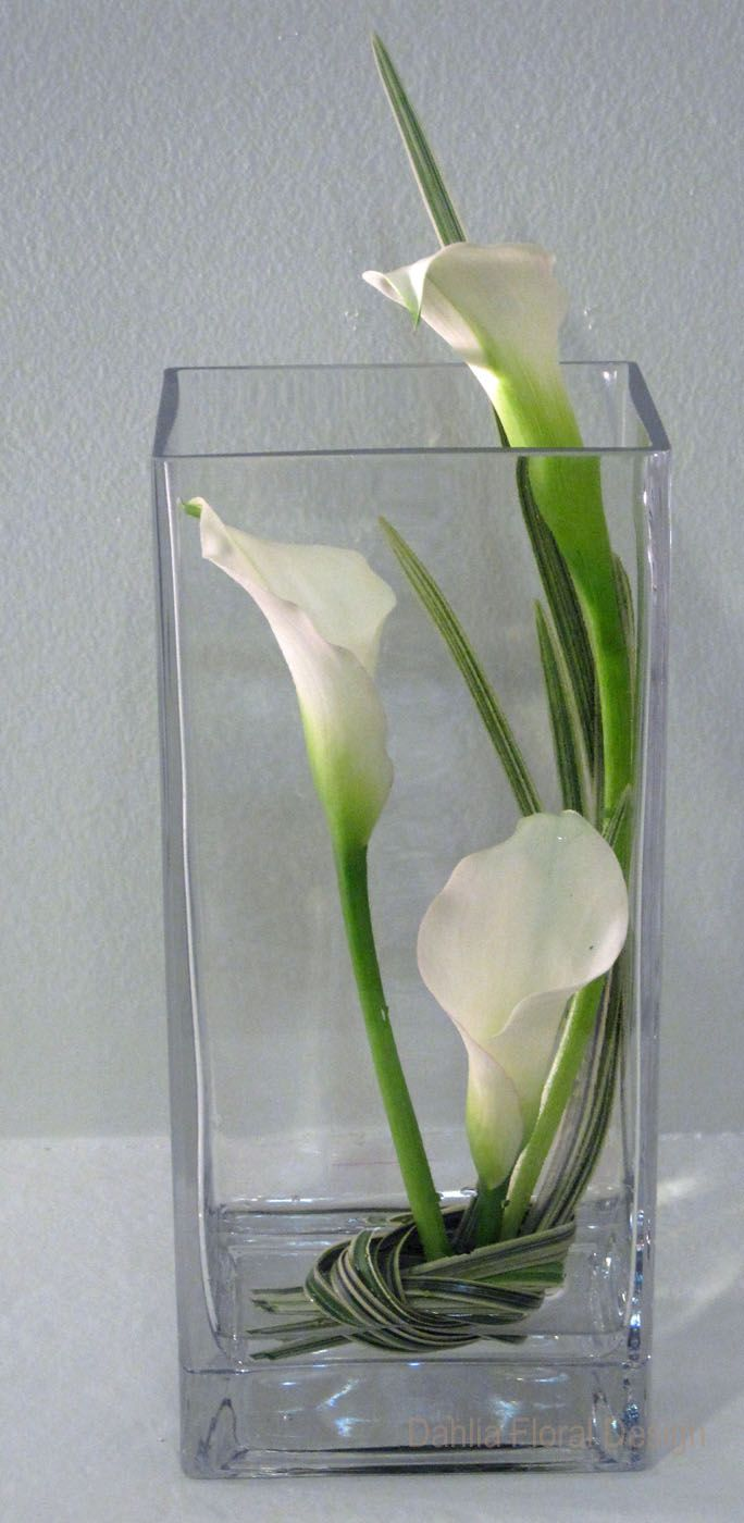 white calla lily inside vase wedding reception table centerpiece flowers