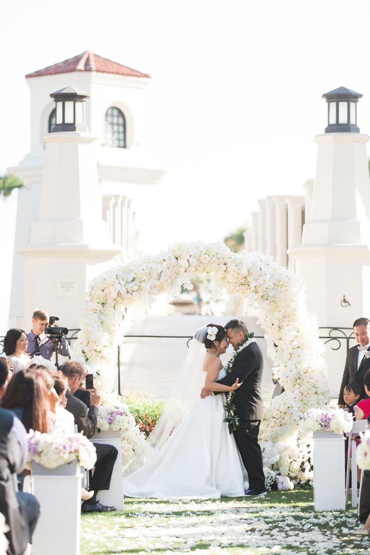 Breathtaking monochrome wedding ceremony with all white floral arch made of roses, hydrangea and orchids. Gorgeous! (Caroline Tran Photography)