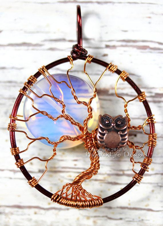 "This tree is bare of leaves like one would see in Winter and features a large, rainbow moonstone ""full moon"" behind the branches. Nestled in the branches is a copper owl bead sitting in the branches of this two tone, brown and copper Tree of Life pendant featuring an Opalite Rainbow Moonstone Full Moon. Handmade and hand wire wrapped."