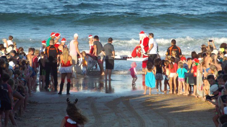 Santa arriving at the Mooloolaba Surf club on Christmas Eve