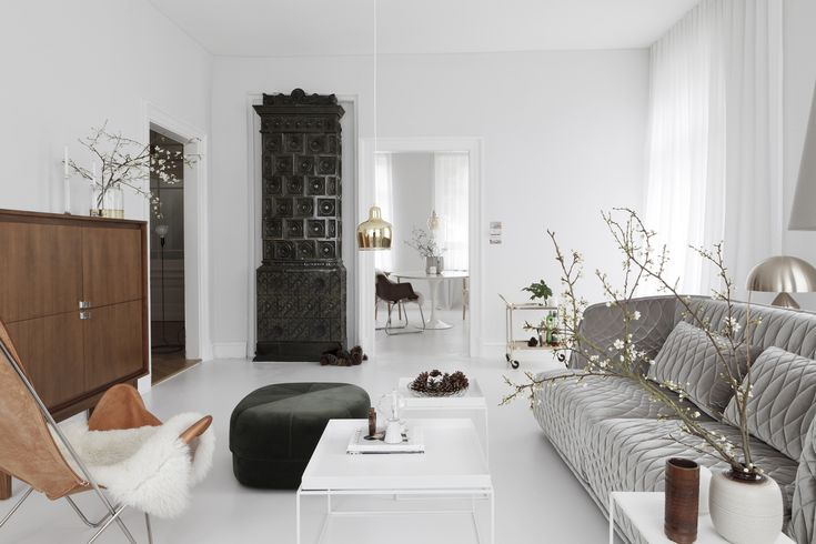 All white living room in a luxe-minimalist apartment remodel by Studio Oink in Mainz, Germany | Remodelista