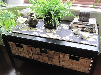 Add baskets and a table runner to make a simple IKEA coffee table so much classier! Love this!
