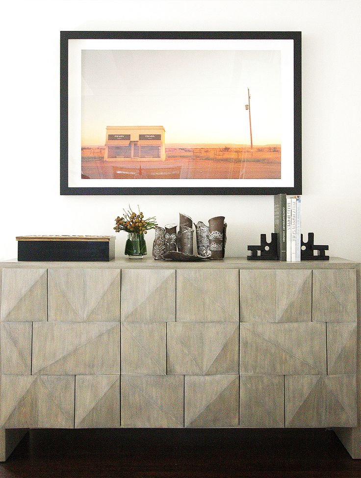 Styled vignette on top of the fireplace