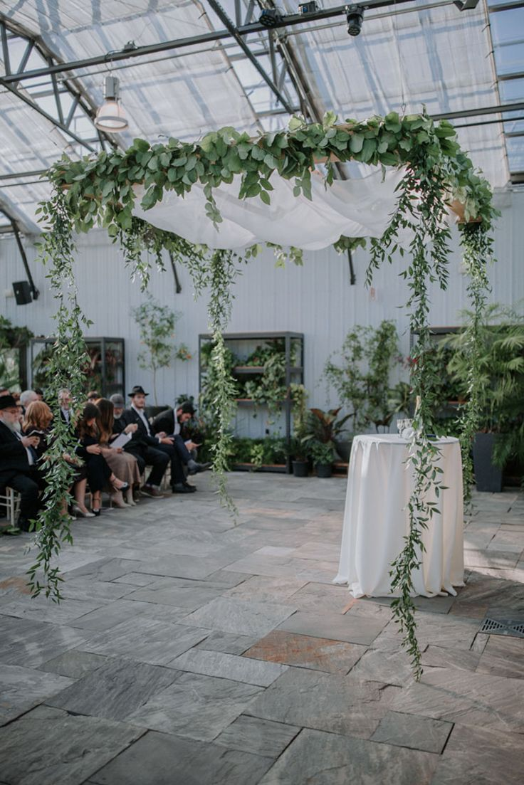 One of the prettiest Chuppahs with greenery all over | A greenery-filled, rustic Jewish wedding in Canada | Smashing the Glass Jewish wedding blog