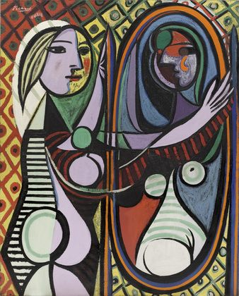 Girl Before a Mirror. Picasso suggests the day-self & night-self, tranquillity & vitality; also Vanity.