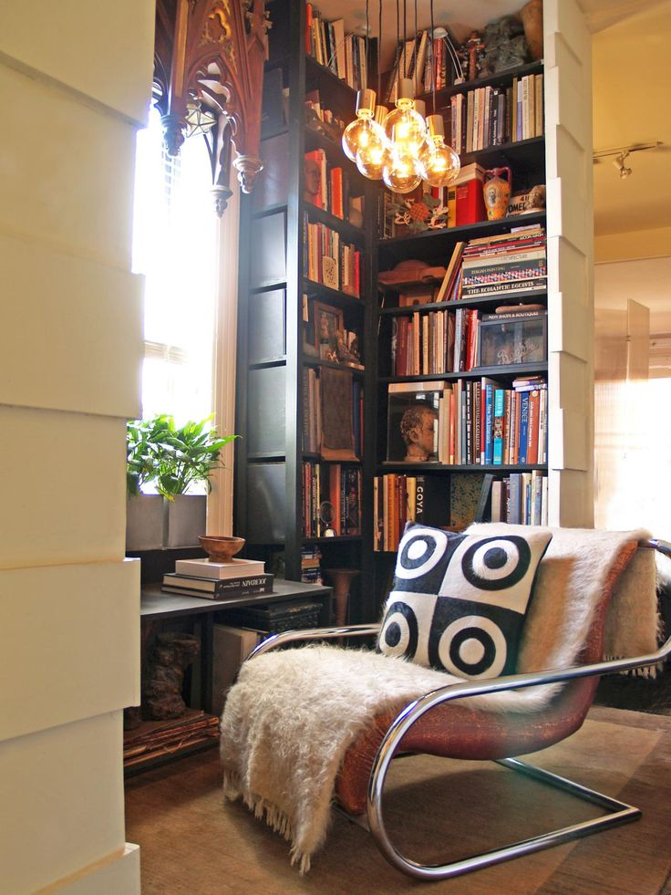 A vintage Mies chair is right at home in this reading nook. The geometric leather pillow from South America adds dimension to the space. Design by Luis Caicedo