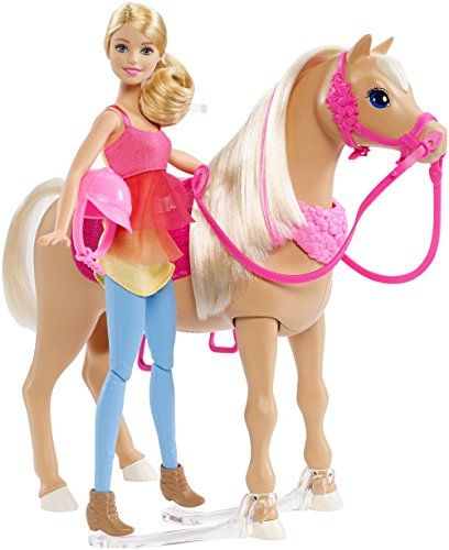 Inspired by the movie Barbie & Her Sisters in a Puppy Chase, Barbie doll and her pretty tan horse can really dance together! Activate the dancing with the push of a button on the horse's mane! The horse plays three different songs, and Barbie doll and her horse have three different ways to get the party started!  toys4mykids.com