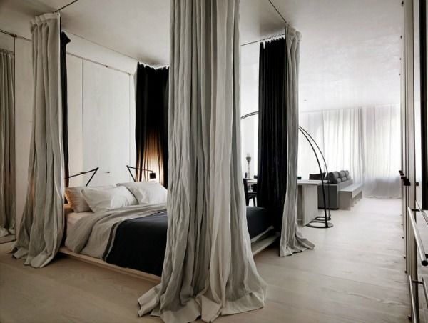 Nancy Mitchell Faked four-poster bed with curtains from ceiling. So pretty and dramatic for a simple room | Rick Joy via Hege in France