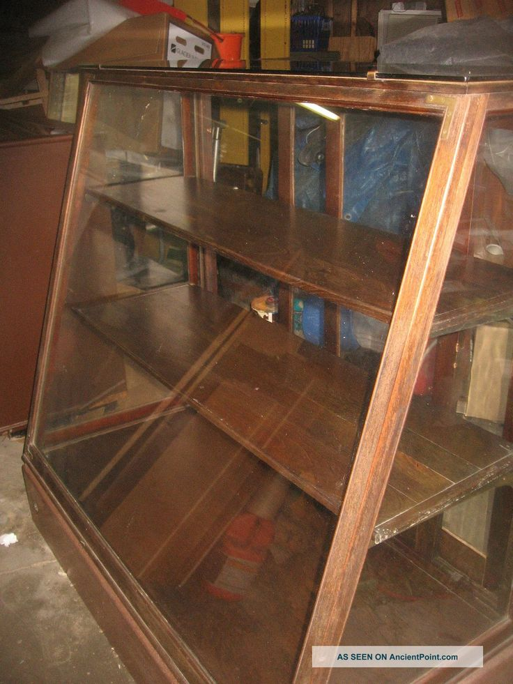 Remember the old glass-front oak display cases in the little old general stores?  Can almost see my nose-print on the glass of the penny candy display case!