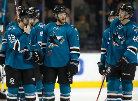 San Jose Sharks' Paul Martin (7) talks with teammates, including San Jose Sharks' Mikkel Boedker (89) and San Jose Sharks' Tomas Hertl (48) following their 4-1 win against the Buffalo Sabres in San Jose, Calif. on Tuesday, March 14, 2017. (Nhat V. Meyer/Bay Area News Group)