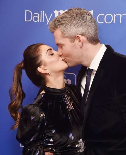 Celebrity PDA of 2017 - December 11, 2017:  Emilia Bechrakis and husband Ryan Serhant shared a smooch at the Daily Mail Holiday Party in New York City on Dec. 6.