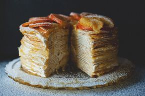 Crepe Suzette Cake - Stovetop. Crepes are stacked with custard cream between layers. Then orange butter sauce is poured over it. Topped with candied oranges. I'm thinking other fruit flavors can be substituted as well.