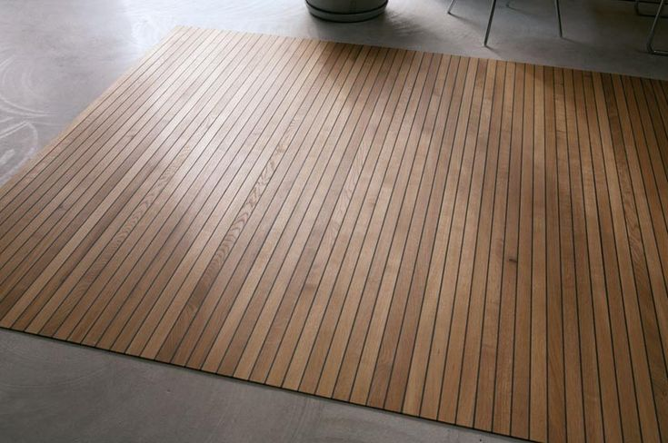 wood 'flooring' that rolls up like a rug. how cool would that be to make a campsite look like a proper room?