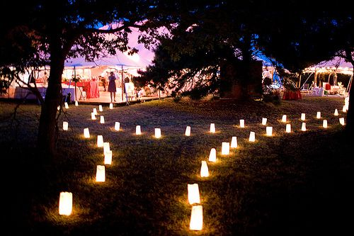 Lighted pathways are a must for outdoor weddings that will lead into outdoor late night parties. I don't particularly like these plain box lights, though.
