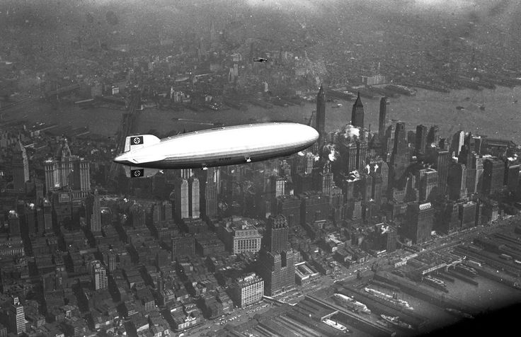 The German zeppelin Hindenburg flies over Manhattan on May 6, 1937. A few hours later, the ship burst into flames in an attempt to land at Lakehurst, New Jersey, (AP Photo)