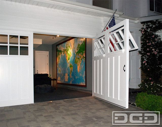<b>Swing out carriage doors for garage door</b> conversions are the perfect way to add curb appeal and functionality to any home. These <b>custom crafted carriage doors</b> replaced an existing <b>roll-up garage door</b> that wasn't working well with the newly converted garage. The overhead track, torsion spring arrangement on the wall and back side of the garage door were just clashing with the finished interior. Replacing the existing <b>overhead garage door</b> with <b>real carriage…