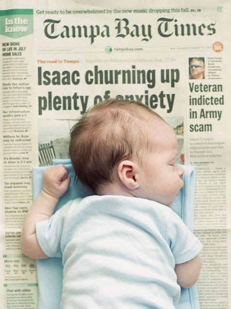 Cute idea!  Baby on a newspaper from the day they were born.  Make sure headline and date are visible!