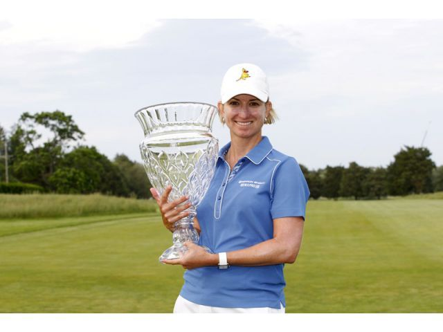 Karrie Webb, ShopRite LPGA Classic GALLOWAY, NJ - JUNE 2: Karrie Webb of Australia holds the championship trophy after winning the ShopRite LPGA Classic Presented by Acer at Stockton Seaview Hotel and Golf Club on June 2, 2013 in Galloway, New Jersey. (Photo by Hunter Martin/Getty Images)
