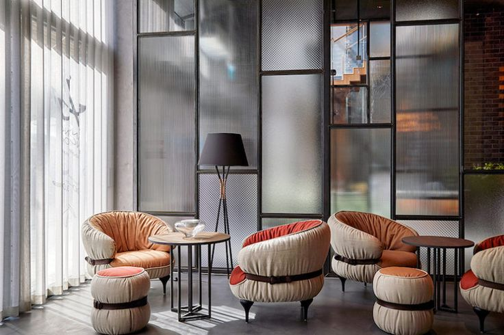 PURO Hotels Brings a Fresh Scene to Old Town Gdansk - Design Milk [[Love the reeded glass wall]]