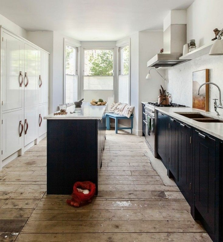 Skye Gyngell kitchen by British Standard, Carrara marble countertop and back splash, Farrow & Ball Hague Blue Cabinets, Double Copper Sink,  Photography by Alexis Hamilton   Remodelista