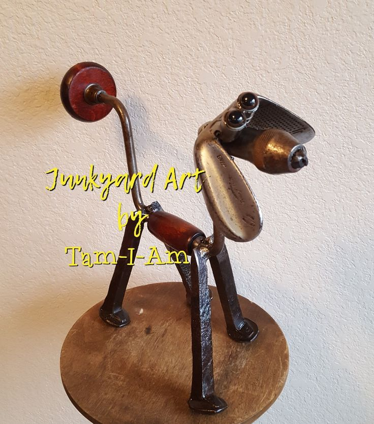 Junkyard Art by Tam-I-Am.  A repurposed hand brace, golf clubs, sockets, and railroad spikes come together to make this hound dog.  Scrap metal art.