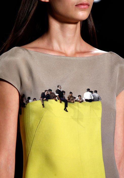 Akris - Photography textiles on a dress that looks like people are sitting on top of a ledge!