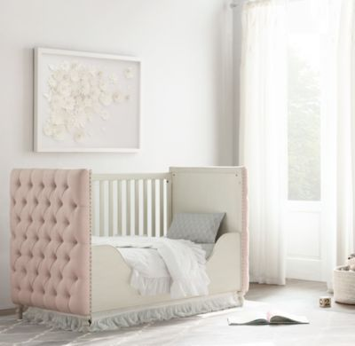 RH Baby & Child's Chesterfield Tufted Crib Toddler Bed Conversion Kit:A tribute to tradition and craftsmanship, our crib replicates the deep hand tufting of a Chesterfield sofa. The classic style – perfected during the Victorian and Edwardian eras – is repurposed here to bring its unrivaled comfort to the nursery.