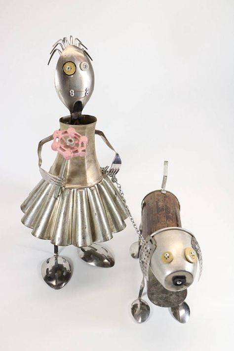 "This is Amanda and her dog scraps assembled from kitchen items and is much more impressive in person. 17"" tall"