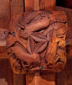 """Three Hares"" medieval roof boss in South Tawton, Devon"