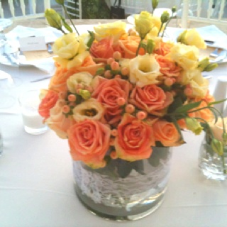 Peach roses with hybericum berries