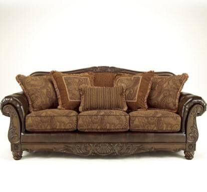 Ashley fresco dura lend sofa.  Another possibility.