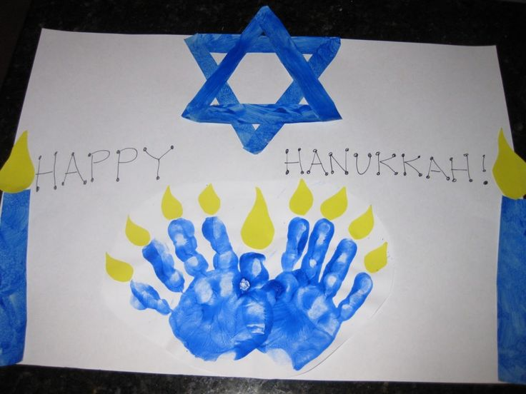 Child's handprints make a one-of-a-kind menorah. Great keepsake for parents!