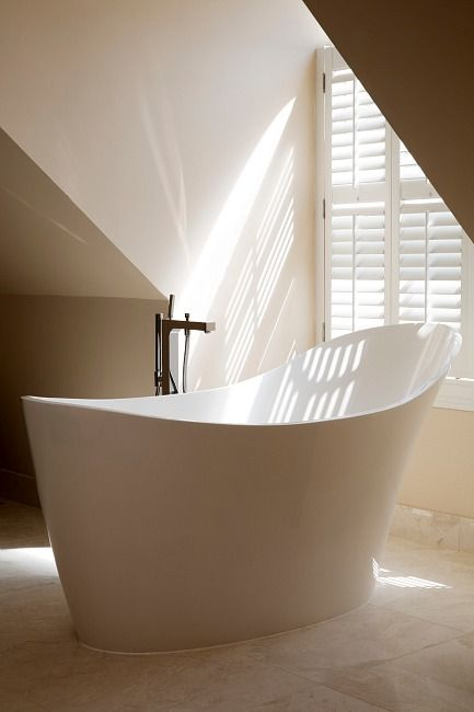Contemporary free standing bath by Halo Design Interiors in a beautiful Oxshott home.