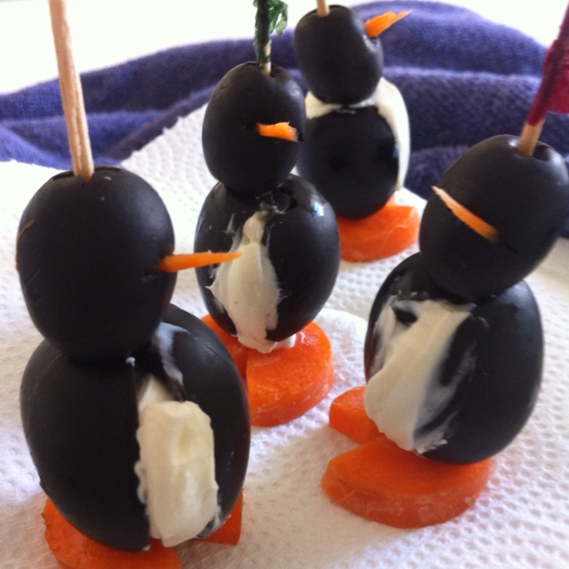 Penguins two different size olives, sliced carrots