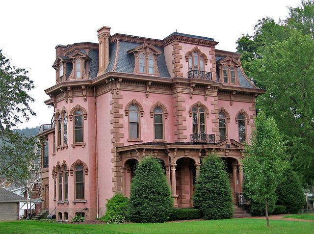 Pink empire style house by Paul McClure I could do without the pink color but I just love the detail on this house.