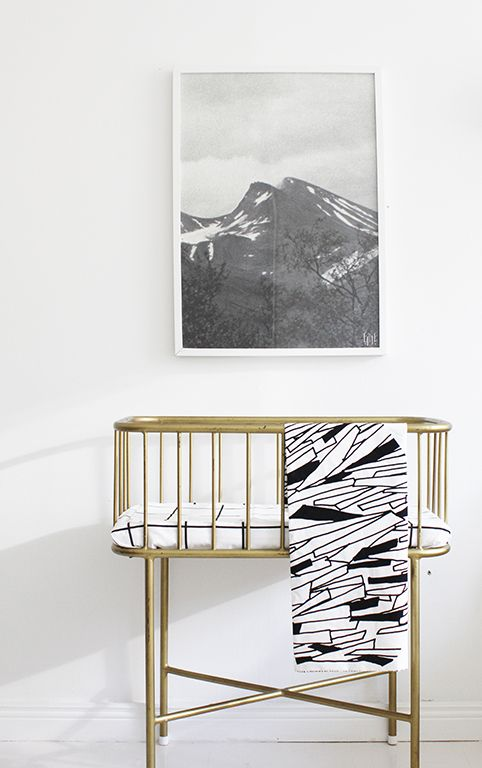 Modern Scandinavian nursery, with a lovely vintage brass colored bassinet