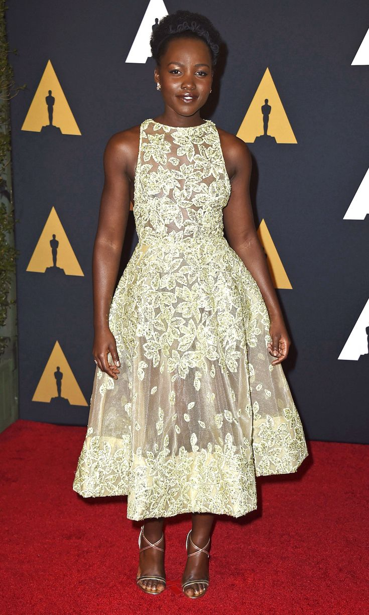 LUPITA NYONG'O   wears a light green Elie Saab Haute Couture A-line dress with delicate leaf motif, Maxior earrings and strappy sandals at the Academy of Motion Picture Arts and Sciences' Governors Awards in Hollywood.