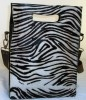 Zwarte leren tas met vacht (zebraprint)
