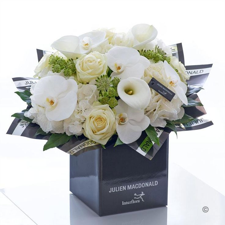 This heavenly bouquet is a pristine presentation of elegant simplicity. The very finest quality fresh flowers in cream, white and ivory are expertly hand-tied to stunning effect. Sleek calla lilies and orchids contrast with intricate rose and hydrangea petals, resulting in an elegant, indulgent, and infinitely beautiful gift.