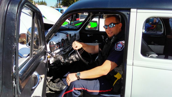 Port Elgin Police Officer trying out the 1948 North Carolina Sheriff Car at Pumpkinfest