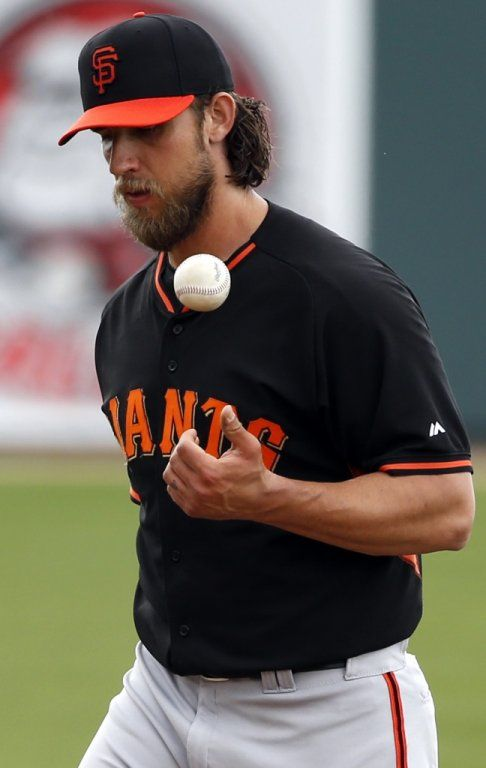 San Francisco Giants' Madison Bumgarner reacts to giving up single to Oakland Athletics' Craig Gentry in 2nd inning in Cactus League opener at Hohokam Stadium in Mesa, Arizona, on Tuesday, March 3, 2015.